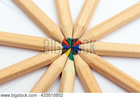 Many Different Colored Pencils.color Pencils In Arrange In Color Wheel Colors On White Background.