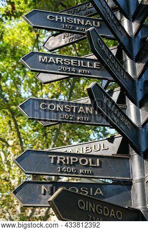 Direction Street Sign Showing Distance Between Cities In Odessa Ukraine. Signpost. Travel Vacation C