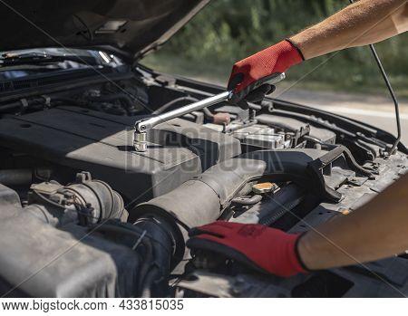 Car Mechanic Repair Auto Engine With Hood Up And Tool, Closeup.