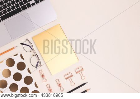 Layout Of Stationery And Laptop On A Beige Background. Neat Workspace For Homeschooling.