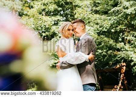 Wedding Day, Just Married. Happy Young Married Couple Hugs Outdoors, Newlyweds Caress Together, Beau