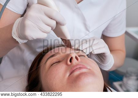 Ultrasonic Facial Cleansing Is A Modern And Safe Deep Facial Cleansing Procedure. Woman At The Recep