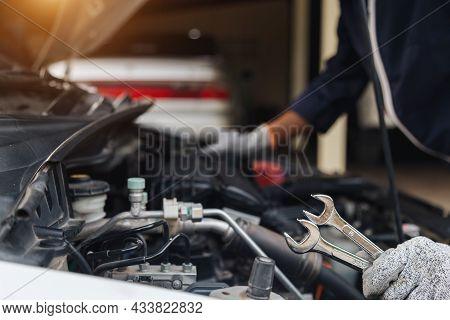 Automobile Mechanic Repairman Hands Repairing A Car Engine Automotive Workshop With A Wrench, Car Se