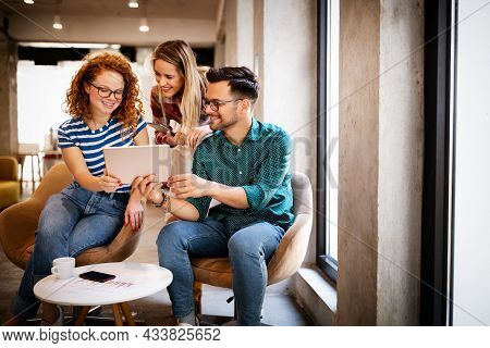 Business People Brainstorming And Chatting At Workplace Office