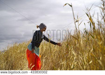 Asian Woman Female Tourist Walking Relaxing In A Field Of Reeds Marsh