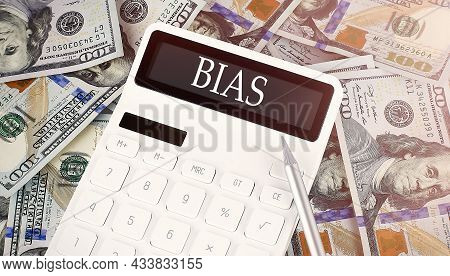 Bias Text On Display Calculator On Dollars Background