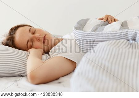 Indoor Short On Young Adult Beautiful Sleeping Female Wearing White Casual T Shirt Lying In Bed Unde
