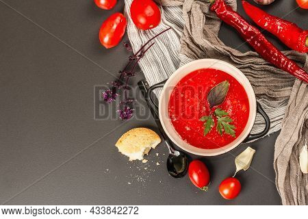 Vegan Food, Spicy Tomato Gazpacho Soup With Toasts, Ripe Vegetables, And Fresh Basil Herbs