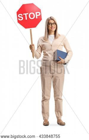 Full length portrait of a young woman holding a book and a stop sign isolated on white background