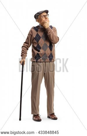 Full length portrait of a senior man with a walking cane standing and thinking isolated on white background