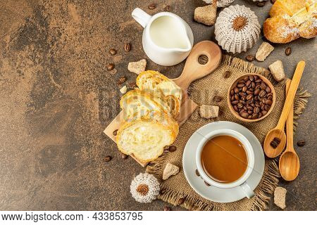 Breakfast Concept With A Cup Of Coffee, Croissants, Milk Jug, And Decorative Crochet Pumpkins