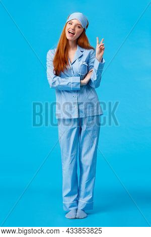 Saying Cheeze. Cheerful And Cute Redhead Upbeat Girl In Glamour Pyjama, Fancy Nightwear Having Sleep