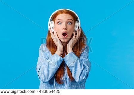 Wow So Clear Sound. Amazed And Enthusiastic Good-looking Redhead Woman In Nightwear, Gasping, Hearin