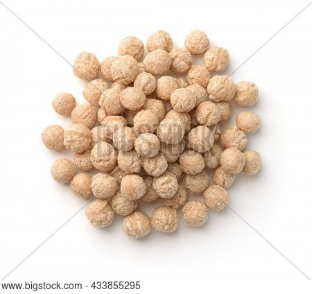Top view of cereal bran puff balls isolated on white