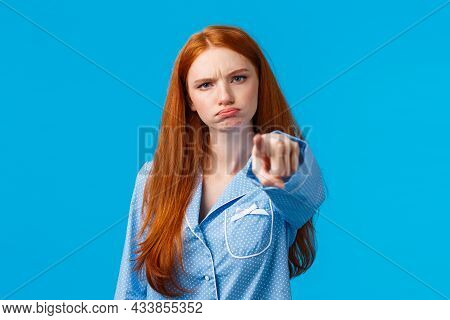 Offended Timid And Silly Redhead Teenager, Girl In Nightwear Pointing At Camera With Blame, Shame So