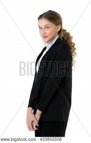 Portrait Of A Surprised Girl In An Elegant Black Suit. Stylish Young Woman In Trendy Black Suit Stan