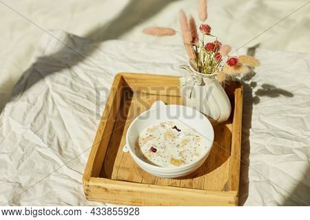 Breakfast In Bed, Try With Bowl Muesli, Granola And Flower In Sunlight At Home