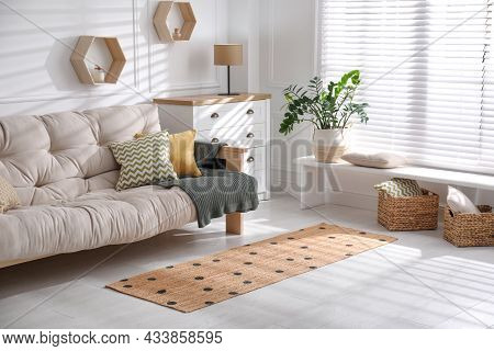 Stylish Rug With Dots On Floor In Living Room