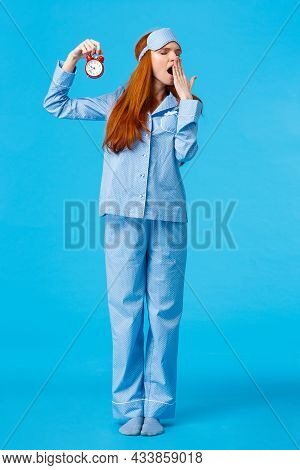 Its So Late Time To Bed. Tired And Sleepy Cute Redhead Female In Nightwear And Sleep Mask, Holding R