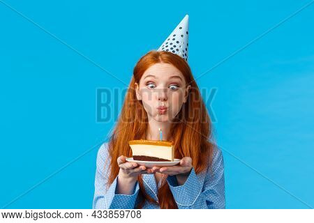 Silly And Cute Glamour Redhead Caucasian Female In B-day Cap And Nightwear, Holding Slice Cake With