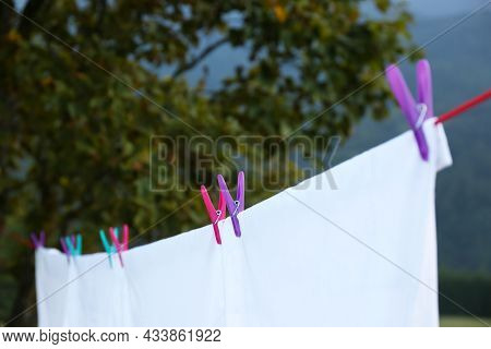Bedclothes Hanging On Washing Line Outdoors, Closeup