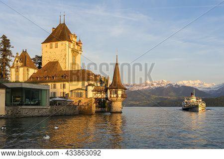 Oberhofen, Switzerland - June 01, 2019: Tourist Boat Near Oberhofen Castle Looking Out Lake Thun And