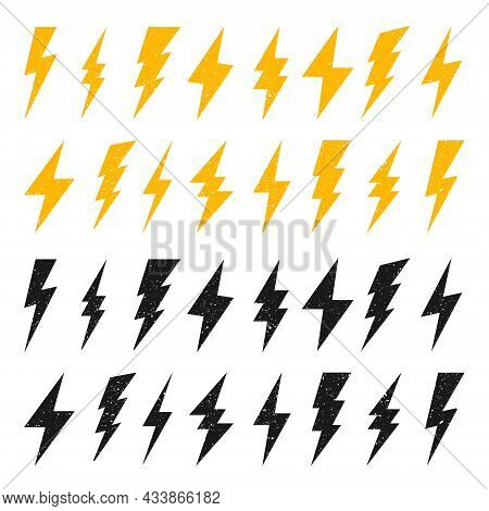Yellow And Black Lightning Bolt Icons With Grunge Texture Isolated On White Background. Vintage Flas