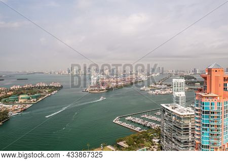 Incredible Aerial View Over The Miami Shipping Channels With The Skyline On The Horizon Beyond And C