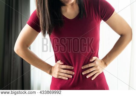 Woman Having Painful Stomachache At Home. Chronic Gastritis. Abdomen Bloating Concept