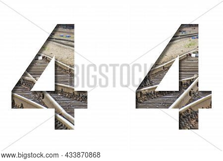 Railway Font. The Number Four, 4 Is Cut Out Of White Paper Against The Background Of Railroad Rails,