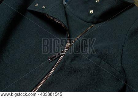 Zipper On A Woman\'s Coat Close-up. Detail Of A Woman\'s Coat
