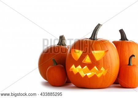 Halloween pumpkin with cut face and candle inside isolated on white background