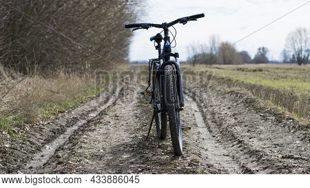 Mountain Bike. Stands On A Field Road. Spring Or Autumn. Concept Of Cycling, Repair Or Breakage. Spo