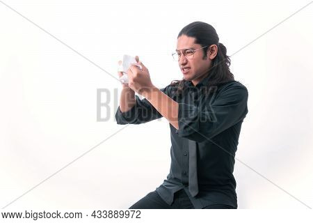 Man On White Background. He Finishes Tearing Up A Page Because He Got Angry About Something He Read.