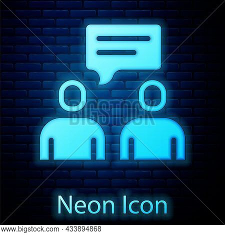 Glowing Neon Two Sitting Men Talking Icon Isolated On Brick Wall Background. Speech Bubble Chat. Mes
