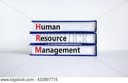 Hrm, Human Resource Management Symbol. Words Hrm, Human Resource Management Symbol On Books On A Bea