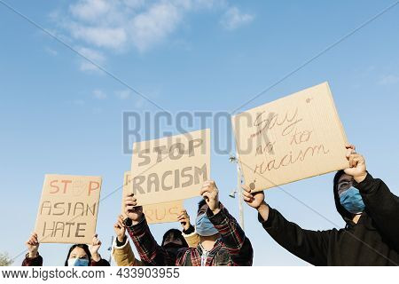 Asian People Protest On The Street Against Racism - Group Of Multiracial Demonstrators From Differen