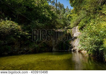 Beautiful Water Stream In Poco Do Linho Waterfall, Vale De Cambra, Portugal. Long Exposure Smooth Ef