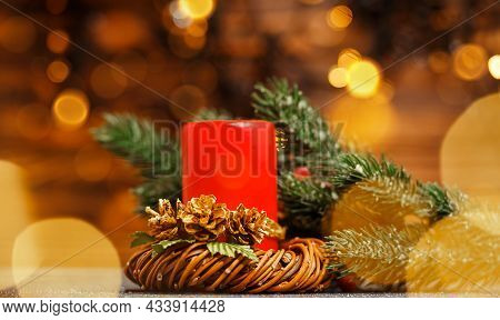 Candle Inside Over Festive Blurry Bokeh Background. Happy New Year Time. Christmas Home Room With Tr