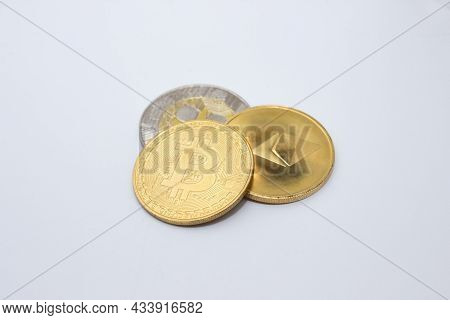 Bitcoin, Ethereum Coin And Ripple Coin Over White Background