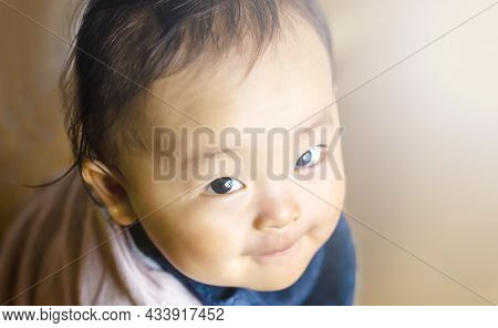 Happy Pretty Baby Boy With Smile And Brown Background And Copy Space.boy Looking At The Camera.