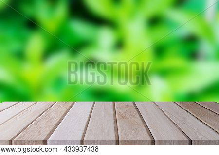 Copy Space Of Blur Nature Leaves Green. Empty Desk Shelf Brown Wooden Plank Of Front. For Showing Pr