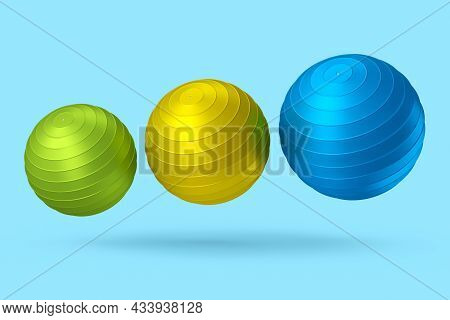 Multicolor Fitball Or Fitness Ball For Yoga Exercise Isolated Blue Background