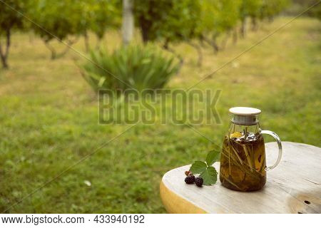 Warm Glass Teapot, Green Tea Leaves And Lemongrass On The Wooden Desk In Plantations, Empty Space Fo