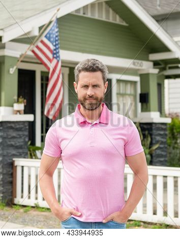Bearded Man Realtor Selling Or Renting House With American Flag, Ownership