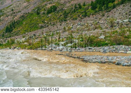 Scenic Nature Background With Rapids On Powerful Mountain River Of Rufous Color. Sunny Vivid Nature