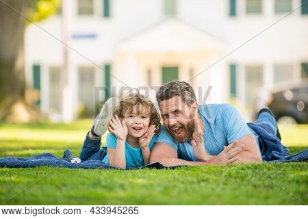 Family Value. Childhood And Parenthood. Parent Relax With Little Child Boy On Grass.