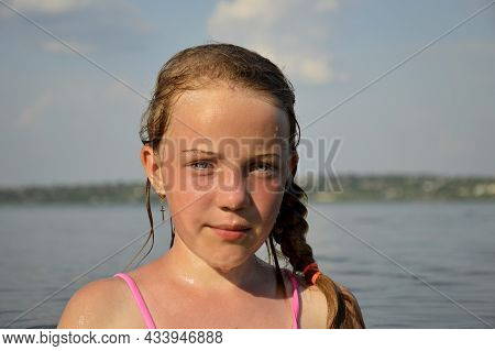 A Beautiful Tanned Girl Is In The Sea Water. Portrait Of A Happy Young Girl Smiling At The Sea. Tann