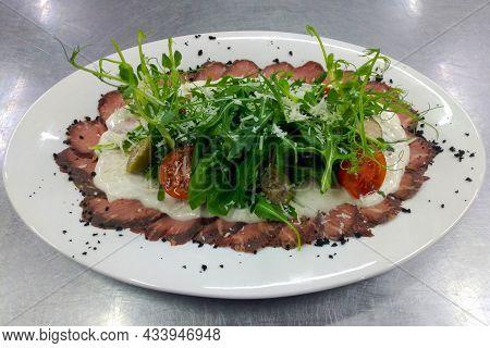 Vitello Tonato - Italian Cuisine Dish Of Baked Veal Slices With Tuna And Caper Mayonnaise Isolated O