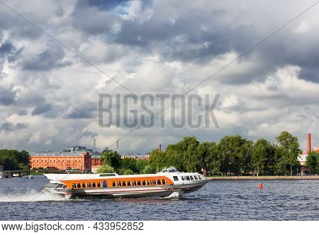 Passenger Boat On The River, Carrying Tourists. St. Petersburg, Neva River. Cityscape, A Beautiful P